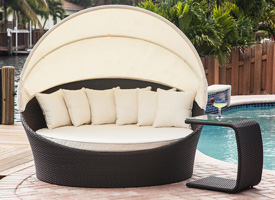 Modern tropea outdoor lounger in black with confortable pad